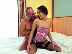 Grandpa eats out a young lady in lovely lingerie