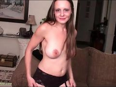 Milf strips to stockings and toy fucks pussy