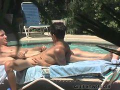 Guys fuck poolside as a voyeur watches them