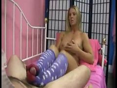 beautiful hot blonde  giving sockjob footjob