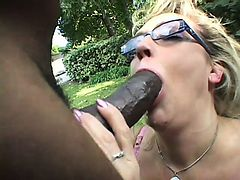 Hot Olivia Saint gulps down every inch of a giant black snake