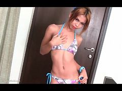Ladyboy bikini chick shows off her little cock